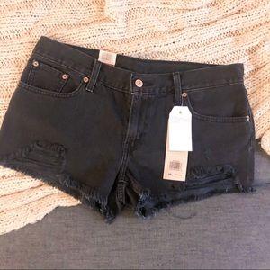 Levi's black distressed shorty shorts